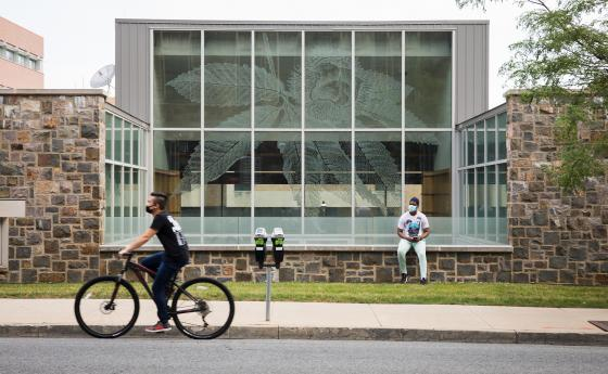 A student rides their bike in front of the STEPS Building at Lehigh University