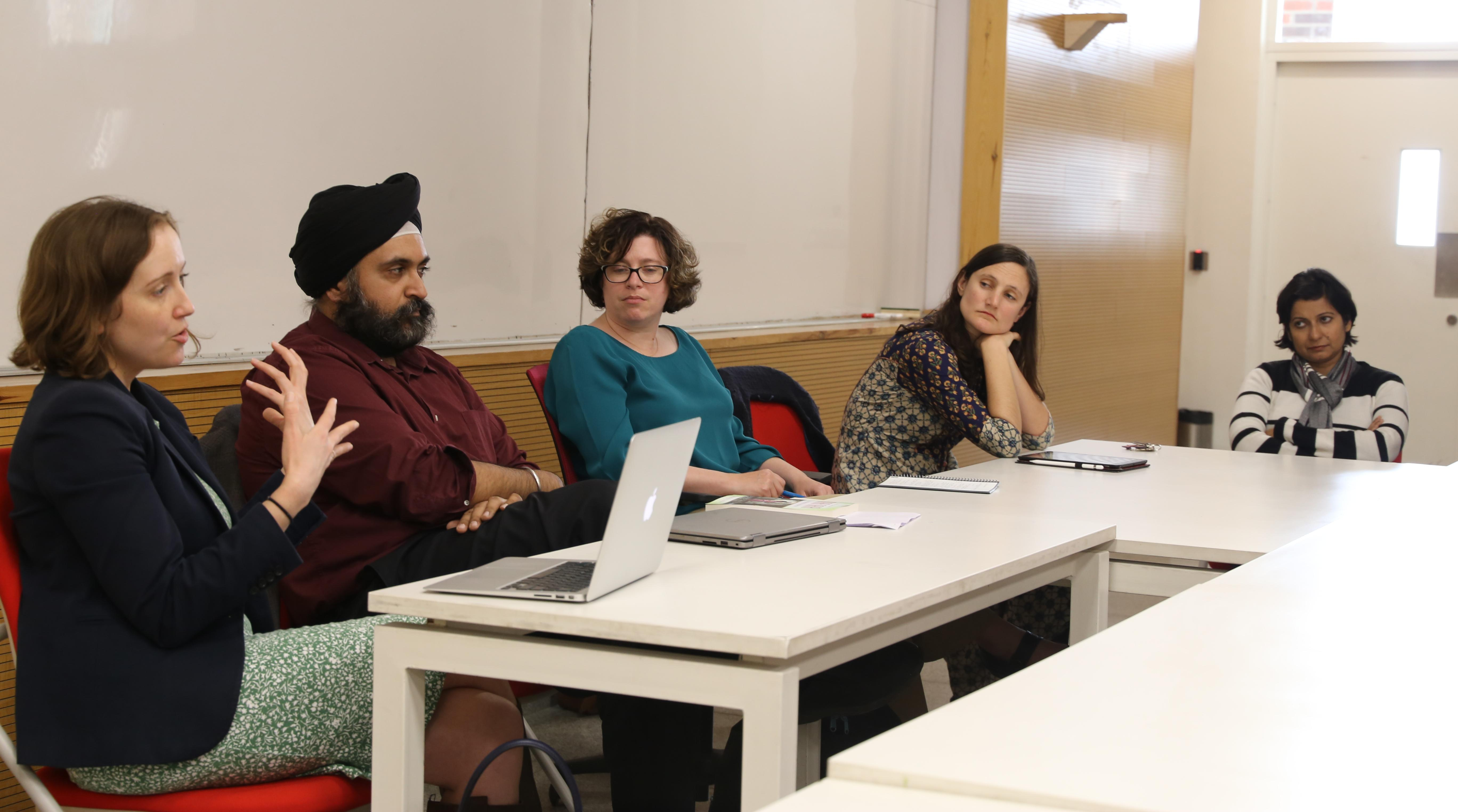 Jenna Lay (left), associate professor of English at Lehigh, discusses her research with colleagues at Ashoka University.